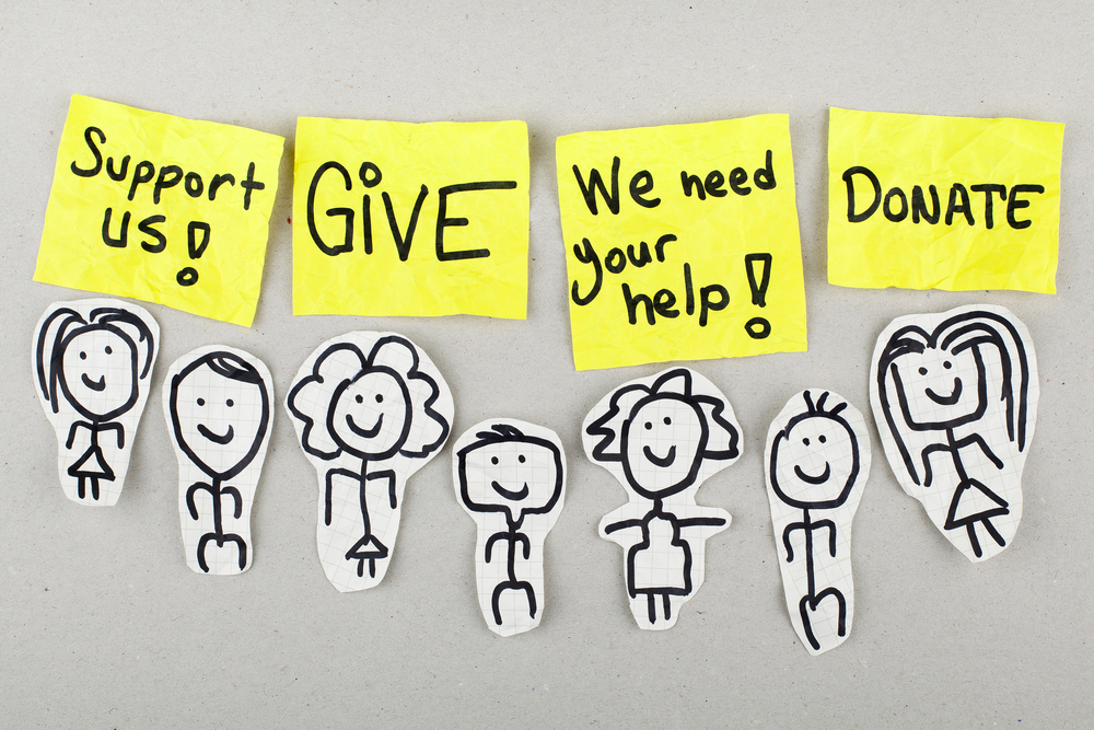 How do charities support the charity runner?